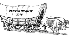 """Conestoga wagon pulled by two oxen; wagon has words """"Denver or Bust 2016"""" on the side."""