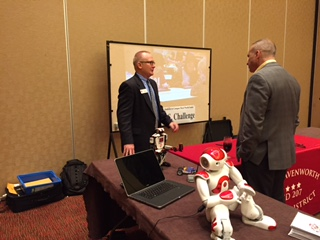 Keith Mispagel (facing) speaking with COL Craig Berryman at the Red the Robot Demonstration Booth