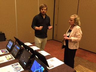 Matthew Dixon explaining Robotics project to a member